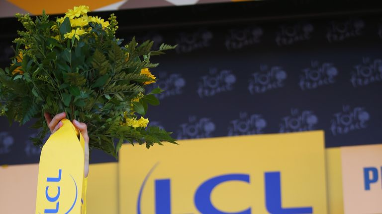 Chris Froome celebrates after taking the yellow jersey on stage three of the Tour de France