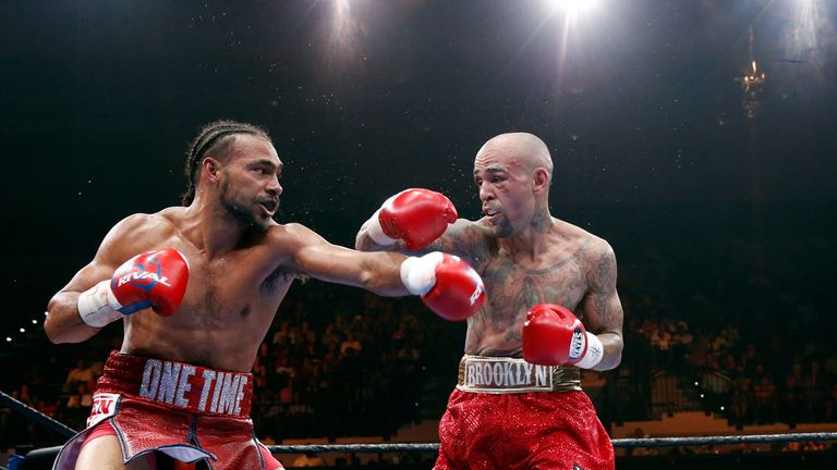 Thurman (left) exchanges blows with Collazo