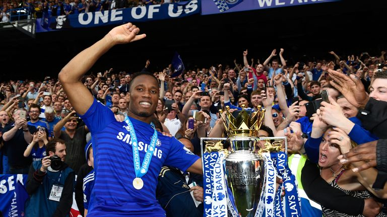 LONDON, ENGLAND - MAY 24:  Didier Drogba of Chelsea celebrates with fans and the trophy  after the Barclays Premier League match between Chelsea and Sunder