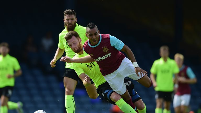 Dimitri Payet of West Ham United battles with Cian Bloger of Southend United  during the pre season friendly match between So