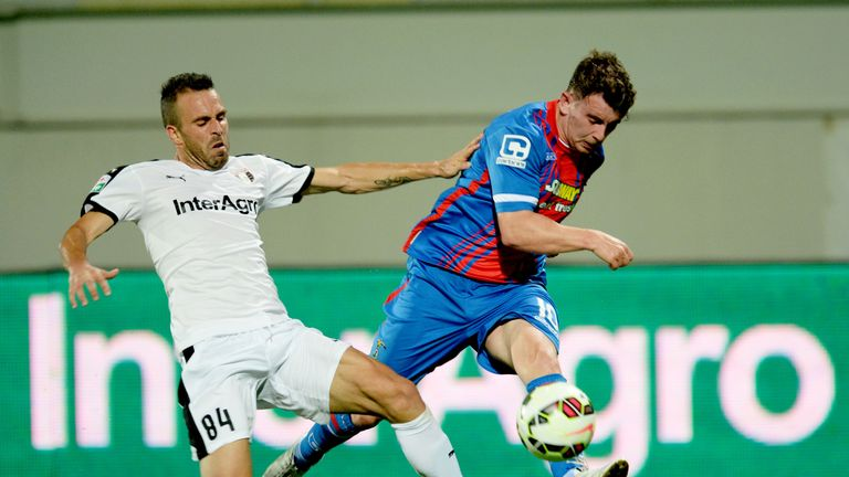 Aaron Doran (right) gets a cross in for Inverness ahead of Astra's Pedro Oueilros