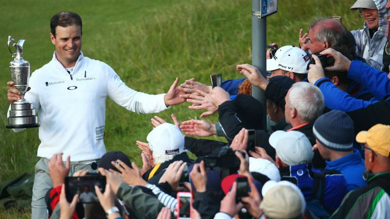 Zach Johnson celebrates with spectators who took advantage of cheap ticket prices