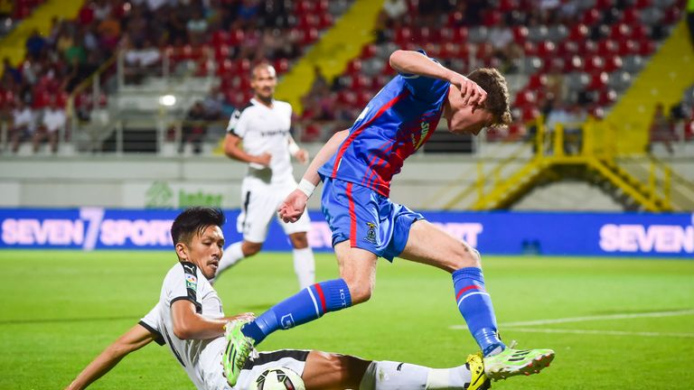 Inverness midfielder Ryan Christie (right) is thwarted by Astra's Takayuki Seto in Romania