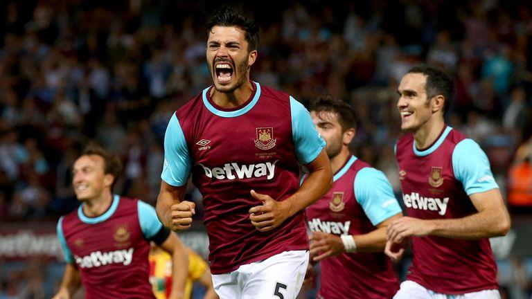 James Tomkins of West Ham United celebrates after his goal.