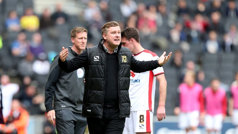 MK Dons manager Karl Robinson shouts encouragement to his players during the Sky Bet League One match between MK Dons and