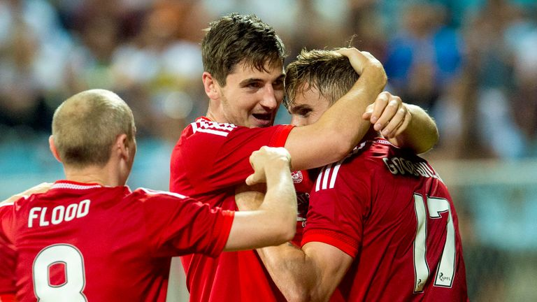 Kenny McLean (middle) celebrates after scoring Aberdeen's third against Rijeka