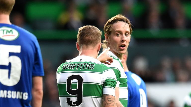 Leigh Griffiths exchanges words with team-mate Stefan Johansen ahead of taking a penalty for Celtic