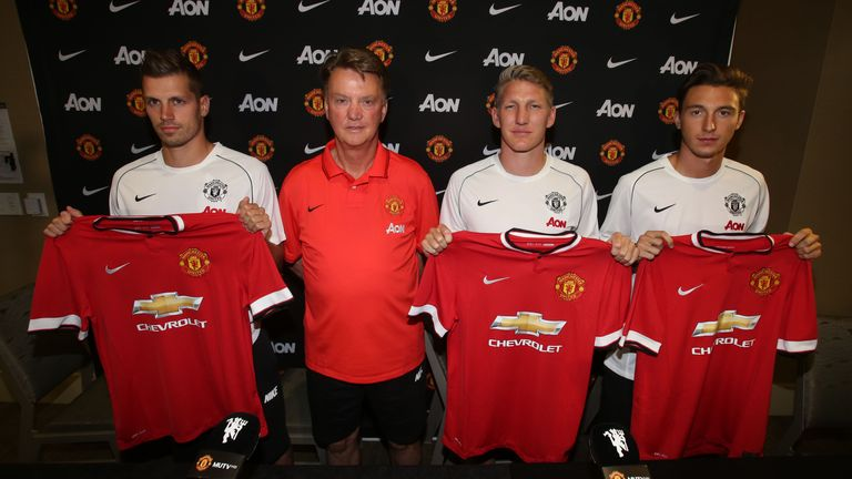 Manager Louis van Gaal of Manchester United poses with his new signings.