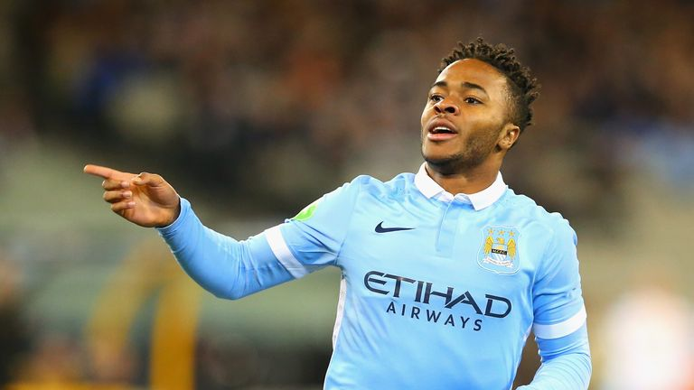 Raheem Sterling wheels away in celebration after his first City goal
