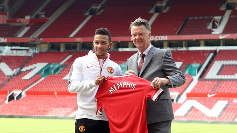 Manchester United's new signing Memphis Depay (left) is unveiled by manager Louis van Gaal