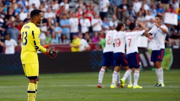 Tottenham goalkeeper Michel Vorm looks on as David Villa (7) celebrates after doubling the lead for the MLS All-Stars