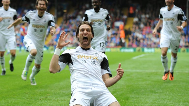 Michu celebrates scoring for Swansea
