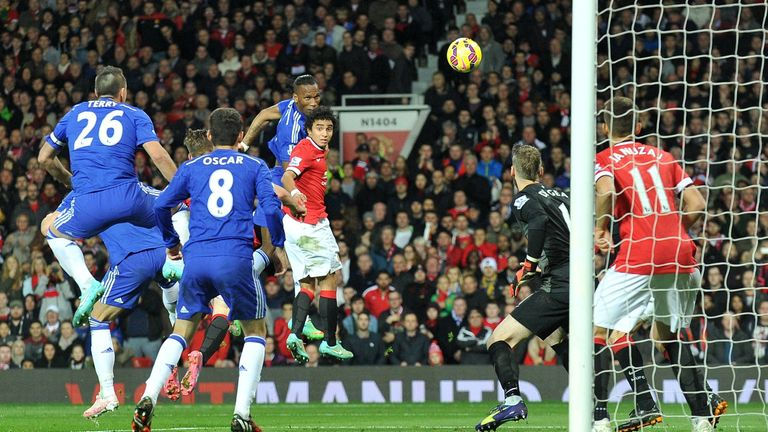 Chelsea's Didier Drogba jumps above Rafael to score against Manchester United.