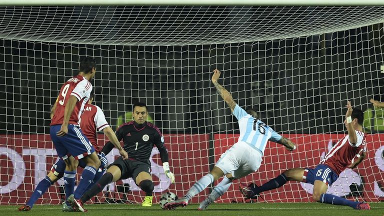 Argentina's defender Marcos Rojo scores the opener