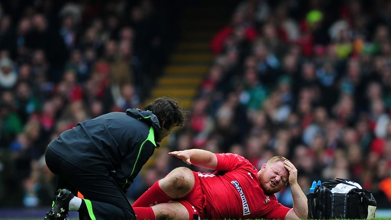 Samson Lee receives medical attention to a leg injury during the RBS Six Nations match between Wales and Ireland