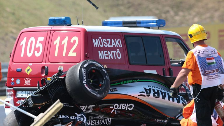 Sergio Perez's car lies upside down on the track in P1