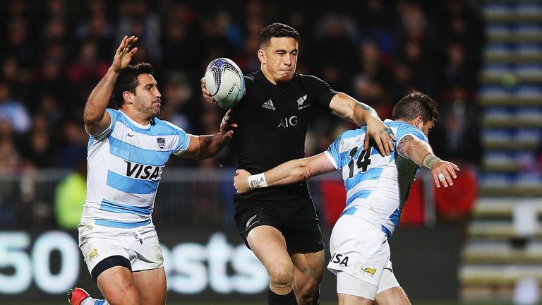 Sonny Bill Williams looks to get his hands free and off load against Argentina