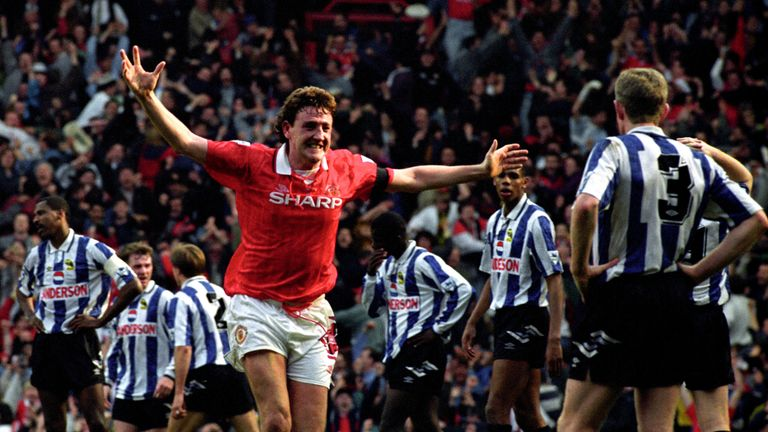 Steve Bruce celebrates his second goal for Manchester United which gave them a 2-1 win over Sheffield Wednesday and the Premier League title, April 1993