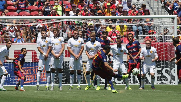 Luis Suarez hits the post with a free-kick against United