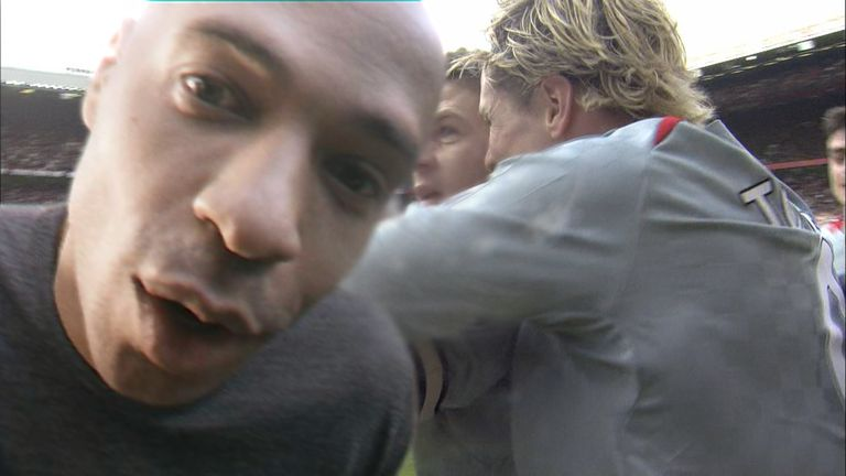 Thierry Henry gatecrashes Liverpool's celebrations at Old Trafford in 2009 - when Steven Gerrard famously kissed the cameran
