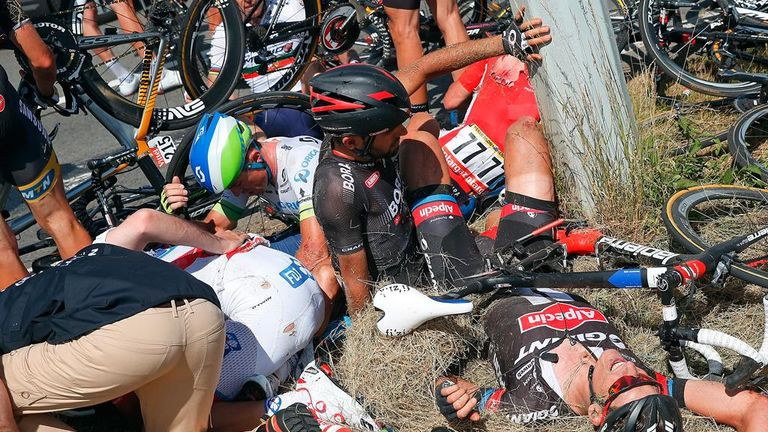 The crash saw riders piled up against a telegraph pole