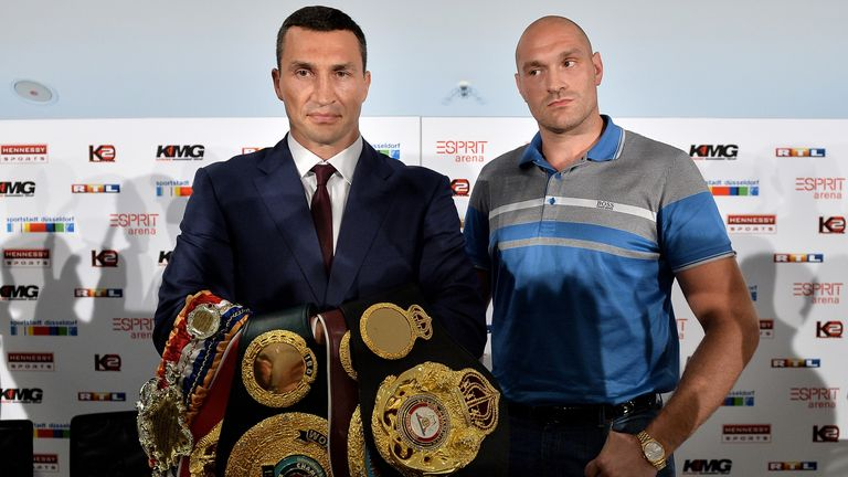 Klitschko and Tyson Fury pose during a pre-fight press conference in Germany