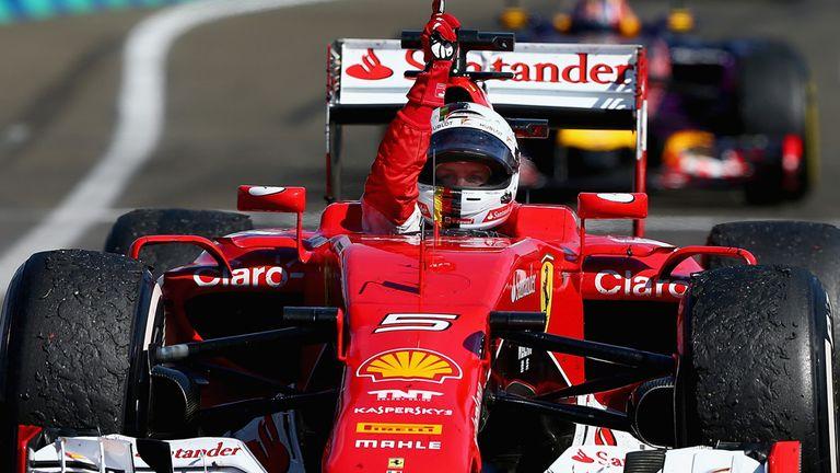 Sebastian Vettel celebrates as he approaches Parc Ferme after winning the Hungarian GP