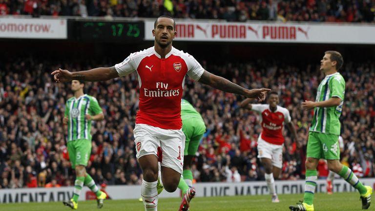Theo Walcott celebrates scoring the opening goal for Arsenal