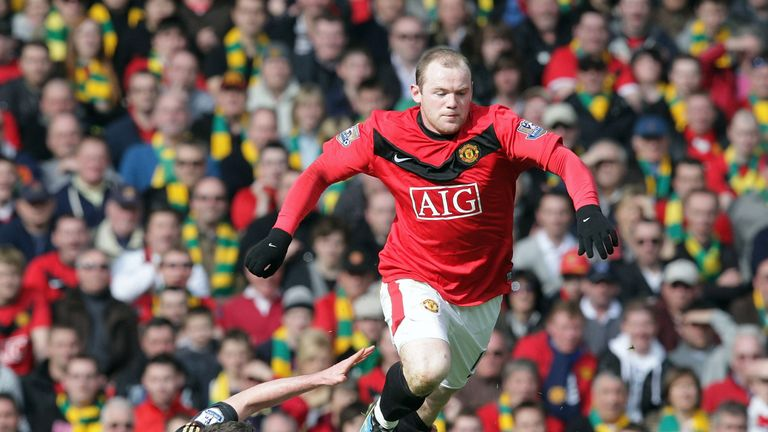 MANCHESTER - MARCH 21 2010: Wayne Rooney of Manchester United clashes with Jamie Carragher of Liverpool during the FA Barclays Premier League match