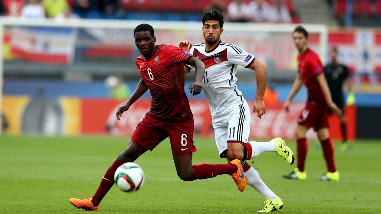 JUNE 27: William Carvalho (L) of Portugal and Emre Can of Germany battle for the ball during the UEFA European
