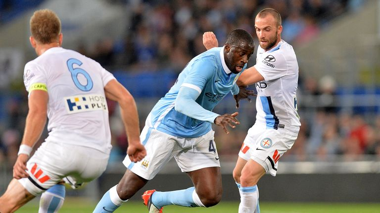 Yaya Toure of Manchester City takes on the Melbourne City defence