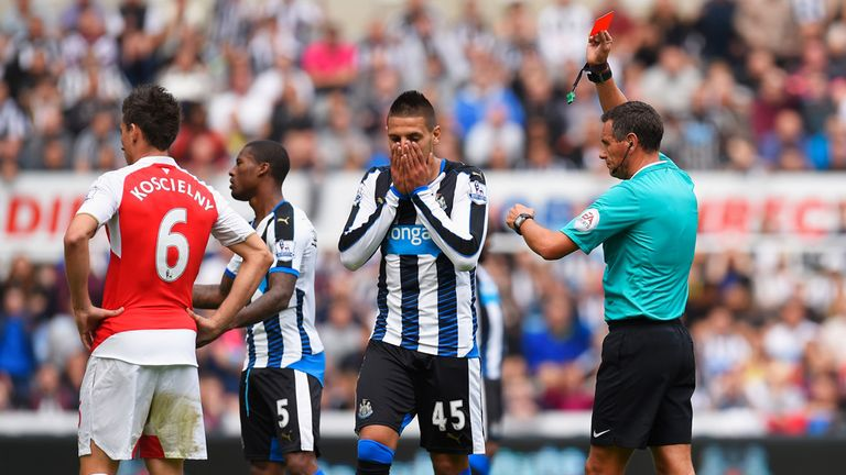 Aleksandar Mitrovic of Newcastle United is shown a red card