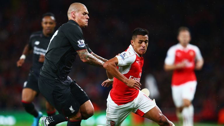 Alexis Sanchez of Arsenal is closed down by Liverpool's Martin Skrtel