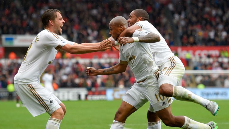 Andre Ayew celebrates with Ashley Williams and Gylfi Sigurdsson