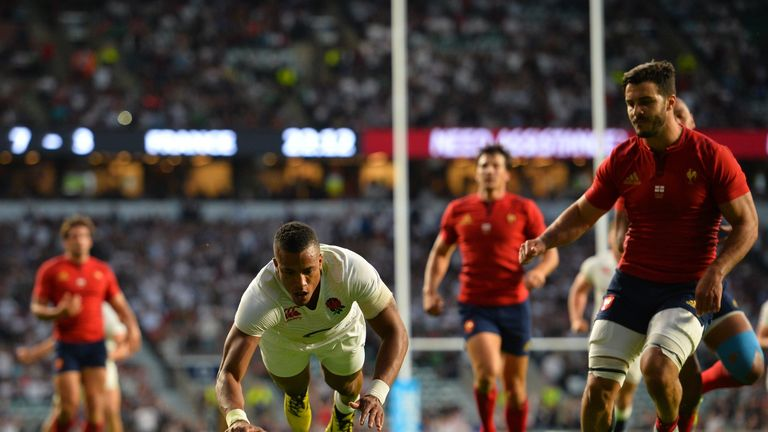 England wing Anthony Watson (C) scores his second try during the World Cup warm-up match against France at Twickenham