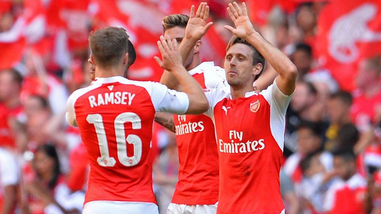 Arsenal players celebrate after the final whistle
