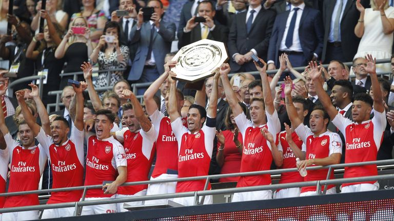 Arsenal's Mikel Arteta (middle) lifts the Community Shield trophy