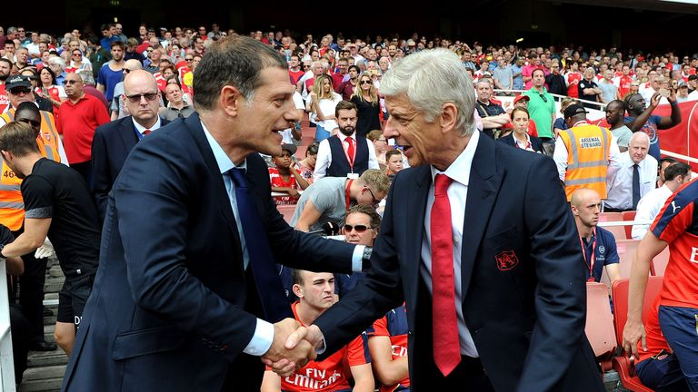 Arsenal manager Arsene Wenger shakes hands with West Ham boss Slaven Bilic before kick-off