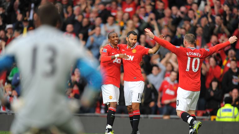 Ashley Young, Ryan Giggs and Wayne Rooney celebrate during Manchester United's 8-2 win over Arsenal