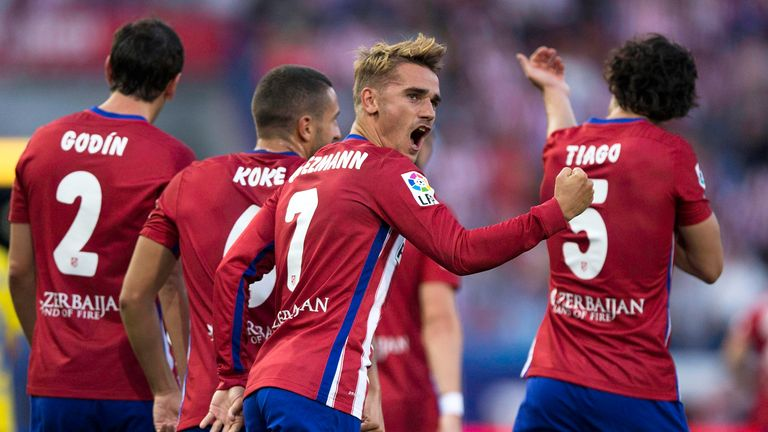 Antoine Griezmann celebrates the only goal of the game