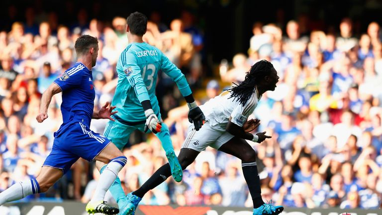 Thibaut Courtois (middle) was sent off for this foul on Bafetimbi Gomis (right)