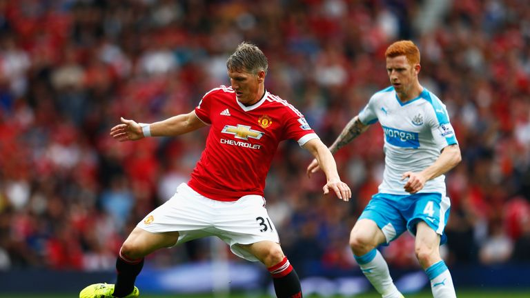 Bastian Schweinsteiger is closely marked by Jack Colback