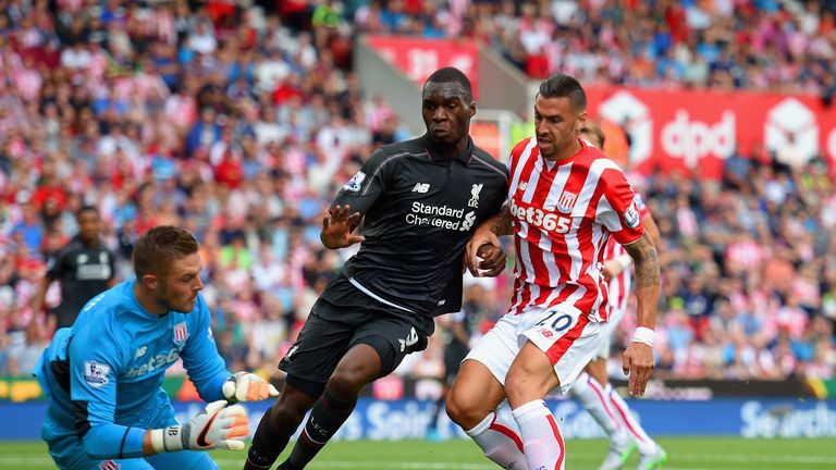 Goalkeeper Jack Butland and Geoff Cameron of Stoke City foil Liverpool's Christian Benteke