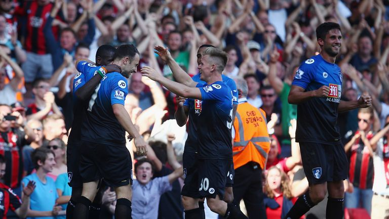 Bournemouth players celebrate their third goal against West Ham, their first win in the Premier League
