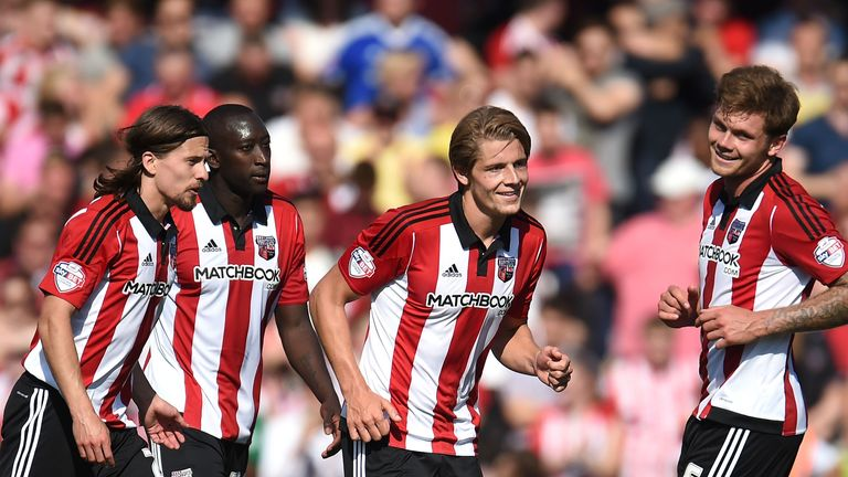 BRENTFORD, ENGLAND - AUGUST 08:  James Tarkowski (2nd R) of Brentford celebrates scoring his side's second goal during the Sky Bet Championship match betwe