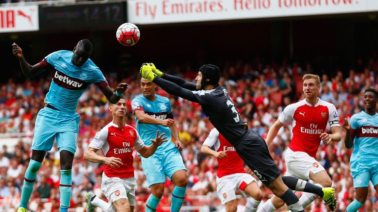 Petr Cech of Arsenal fails to punch clear as Cheikhou Kouyate heads home