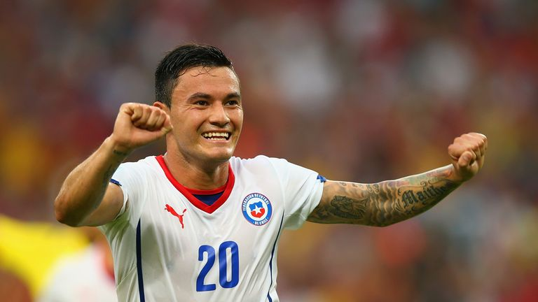 Charles Aranguiz of Chile celebrates scoring against Spain during the 2014 FIFA World Cup.