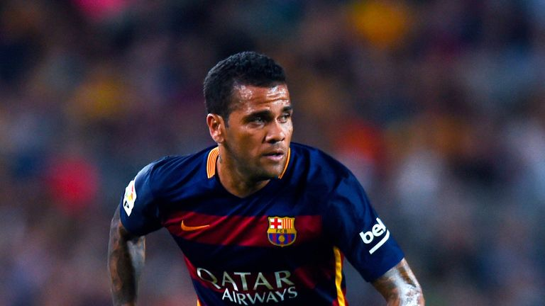 Dani Alves of FC Barcelona runs with the ball during the Joan Gamper trophy match at Camp Nou on August 5, 2015 in Barcelona, Spain.