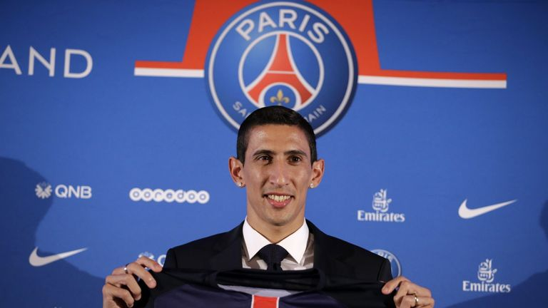 Angel Di Maria poses with his PSG jersey during his official presentation in Paris.