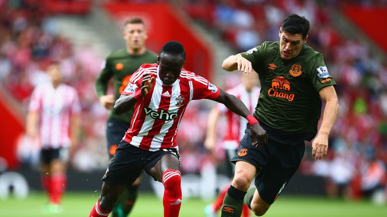 Sadio Mane of Southampton and Gareth Barry of Everton compete for the ball